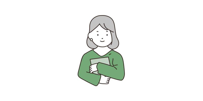エンディングノートを抱える若い女性